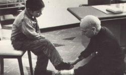 Fr Pedro Arrupe SJ shining shoes for a children in Quito, Ecuador in 1971.