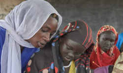 Refugee woman teaches class in South Sudan