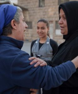 Sr Hala greets a woman who regularly attends JRS activities in Aleppo, Syria.