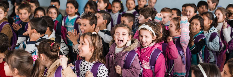 Children on the schoolyard of Jbeil educational centre.