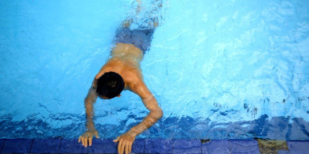 Najib, Afghan refugee, swimming in Indonesia.