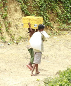 Two Rohingya children walk in the Kutupalong camp in Cox's Bazar, Bangladesh