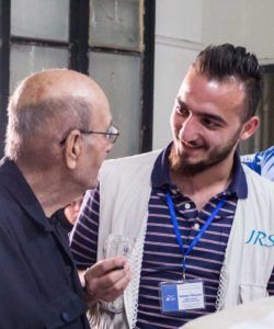 JRS Syria team member accompanies a beneficiary
