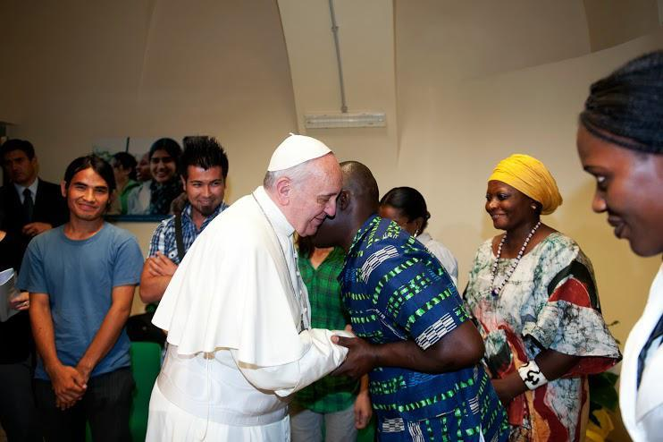 Pope Francis with migrants