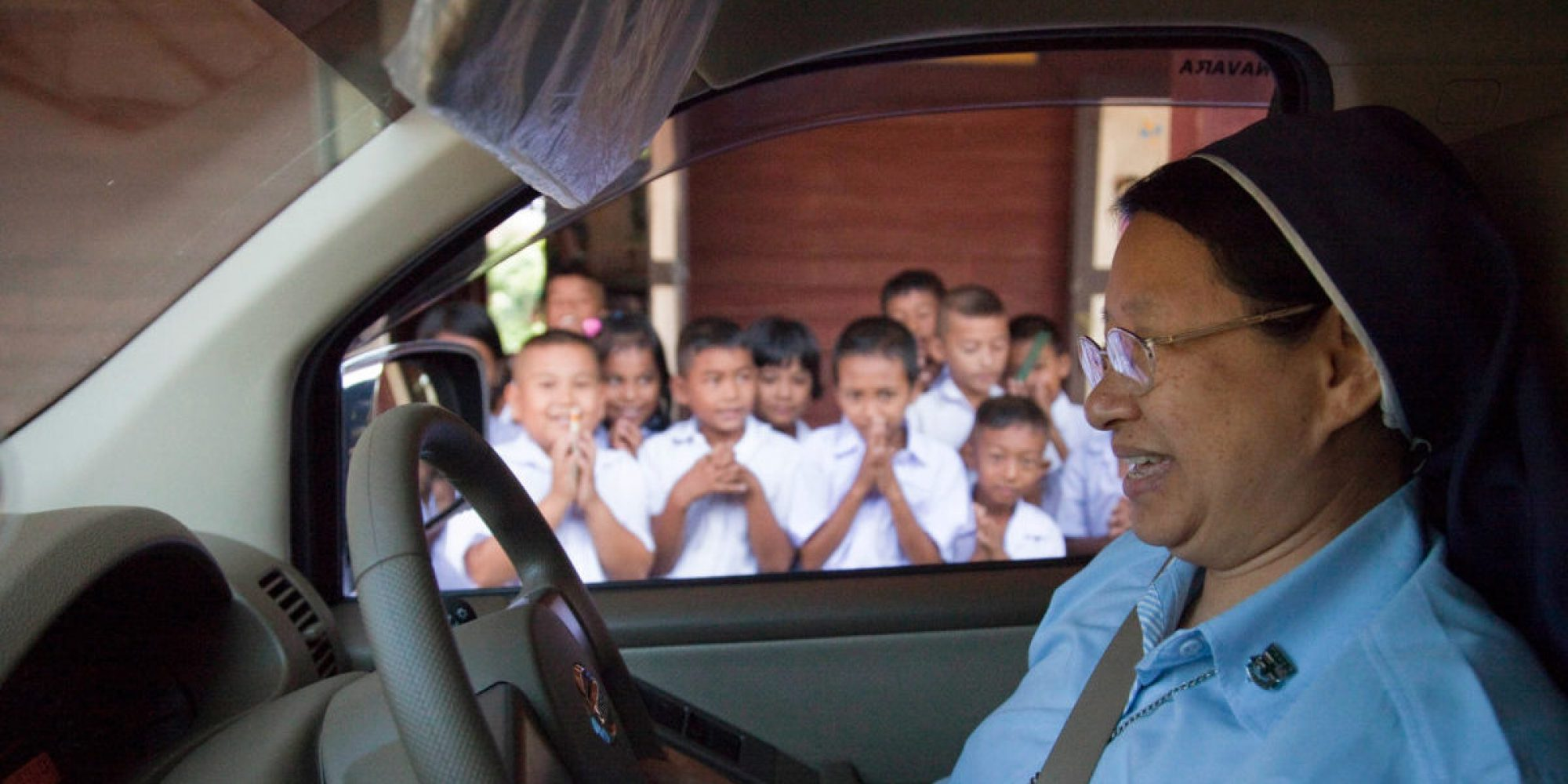 JRS project director, Sr. Sirilak Suwapap, OSU, Ursuline nun, departs a training center for Burmese children who are brought up to speed in Burmese, Thai and English languages.