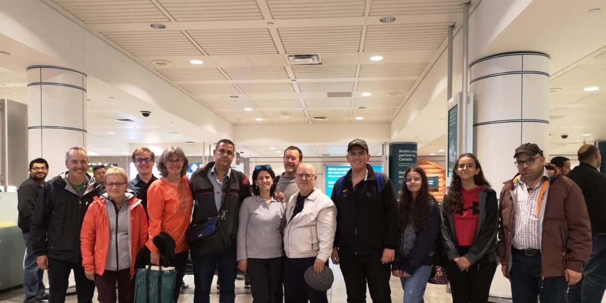 A refugee family from Syria sponsored by JRS Canada at their arrival at the Montreal Airport welcomed by members of the JRS Canada Team.