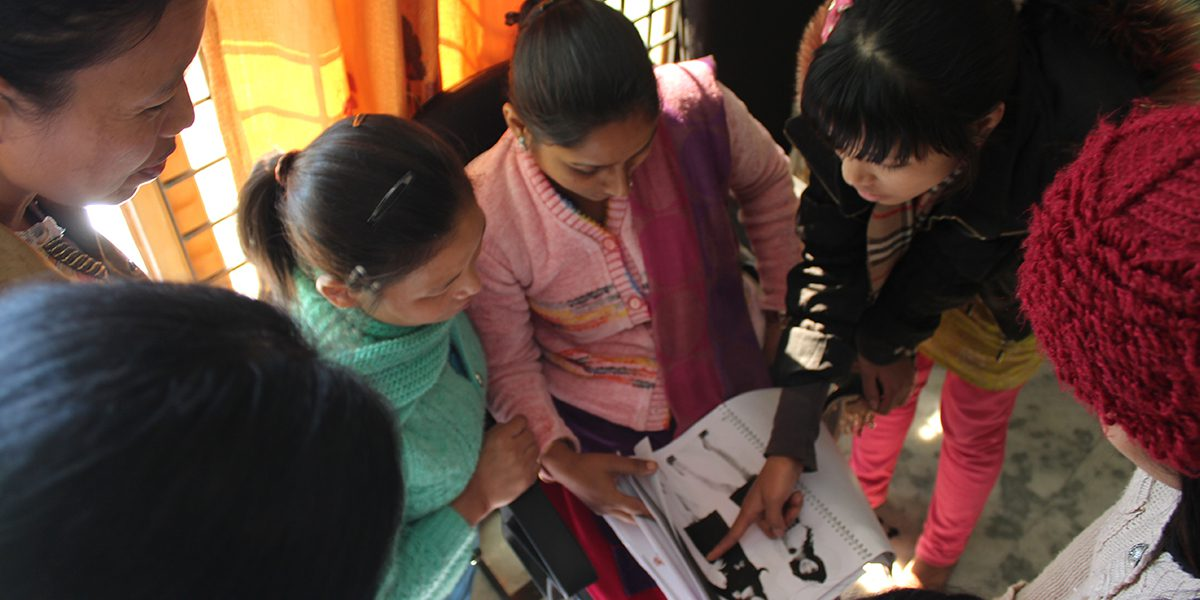 19 women graduated from JRS's first tailoring course receive a sewing maching and cloth to start their own livelhidood.