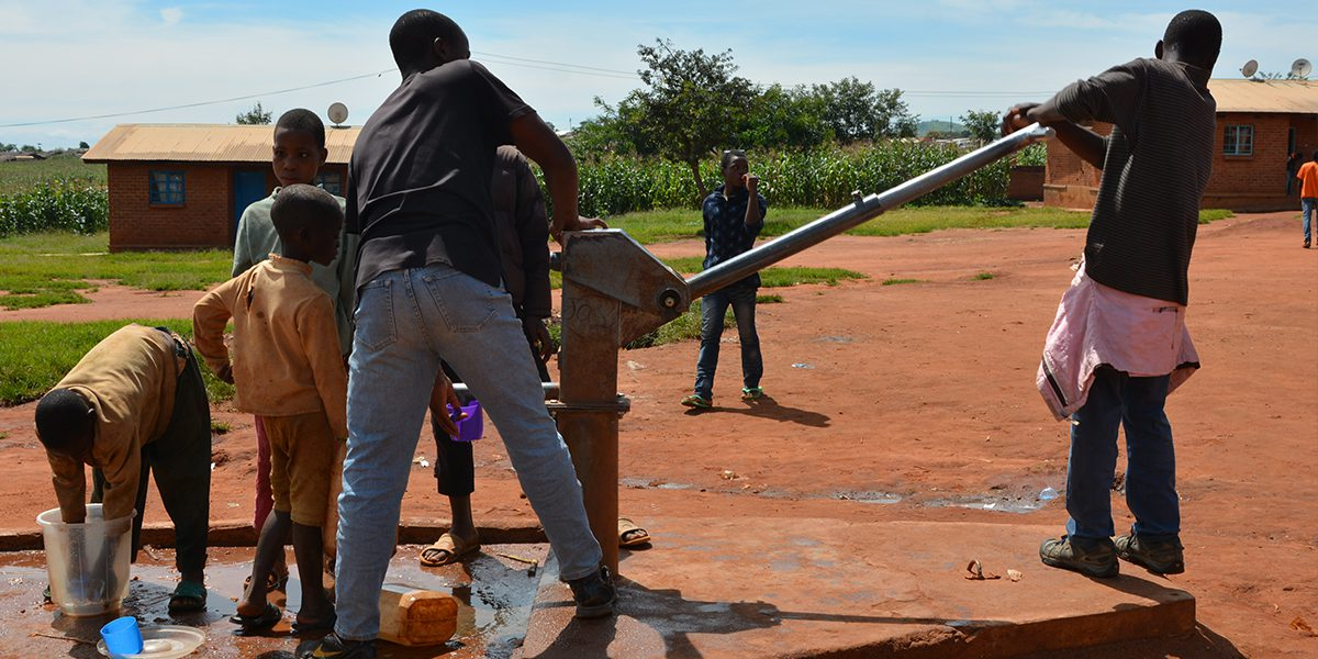 Pumping water from a well in the Dzaleka refugee camp.