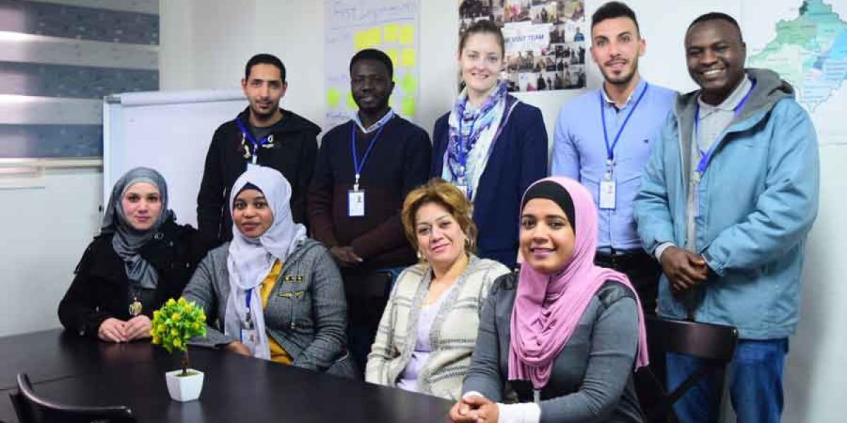 Elizabeth with her team in the JRS office in Amman, Jordan.