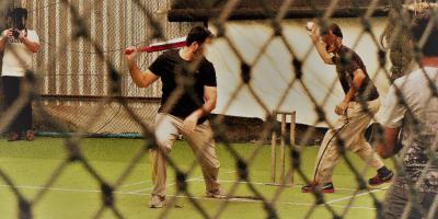 Pakistani refugees playing cricket in Bangkok.