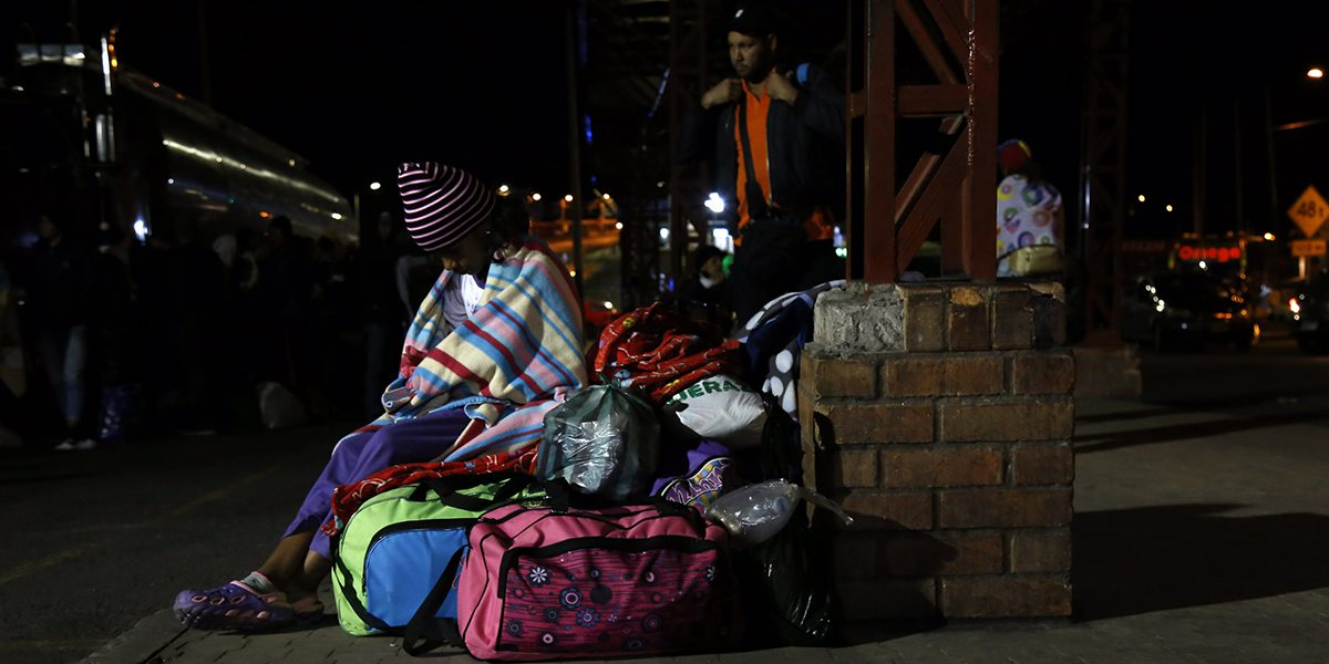 A Venezuelan and their belongings in Tulcán, Ecuador.