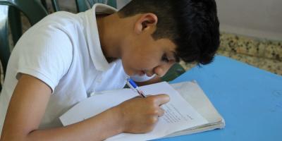 Syrian child studying