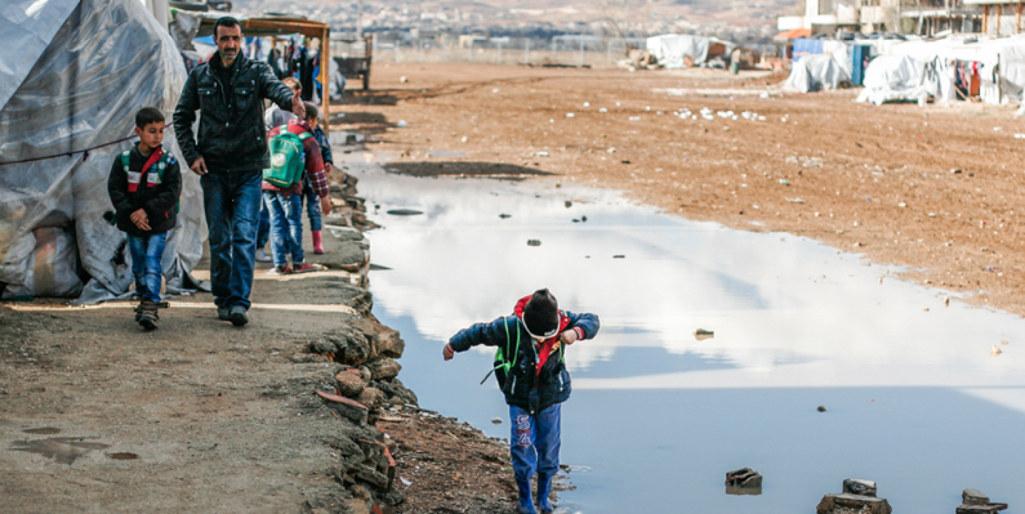 Syrian refugees walk to school at a refugee camp in Bekaa Valley, Lebanon. The country currently hosts over 1 million refugees. The EU can and should do more to take care of the forcibly displaced, thereby relieving pressure on other countries.