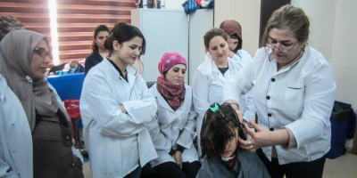 Avin and other girls at the hairdressing classes conducted by the Centre.