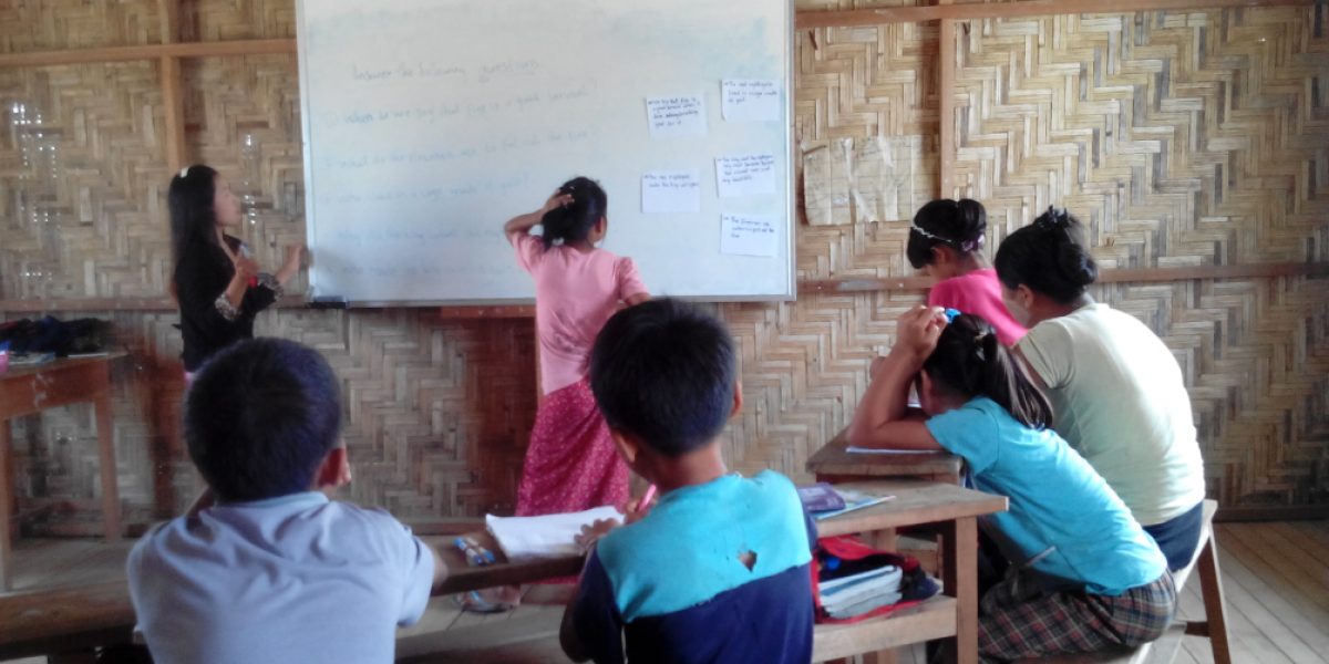 Children attend a class at the JRS school.