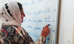 Yazidi woman attending literacy course