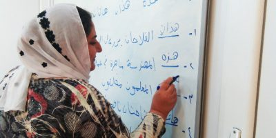 Yazidi woman attending literacy course