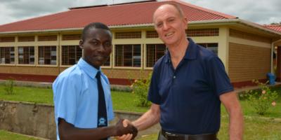 Vumilia with Fr Thomas H. Smolich, JRS International Director
