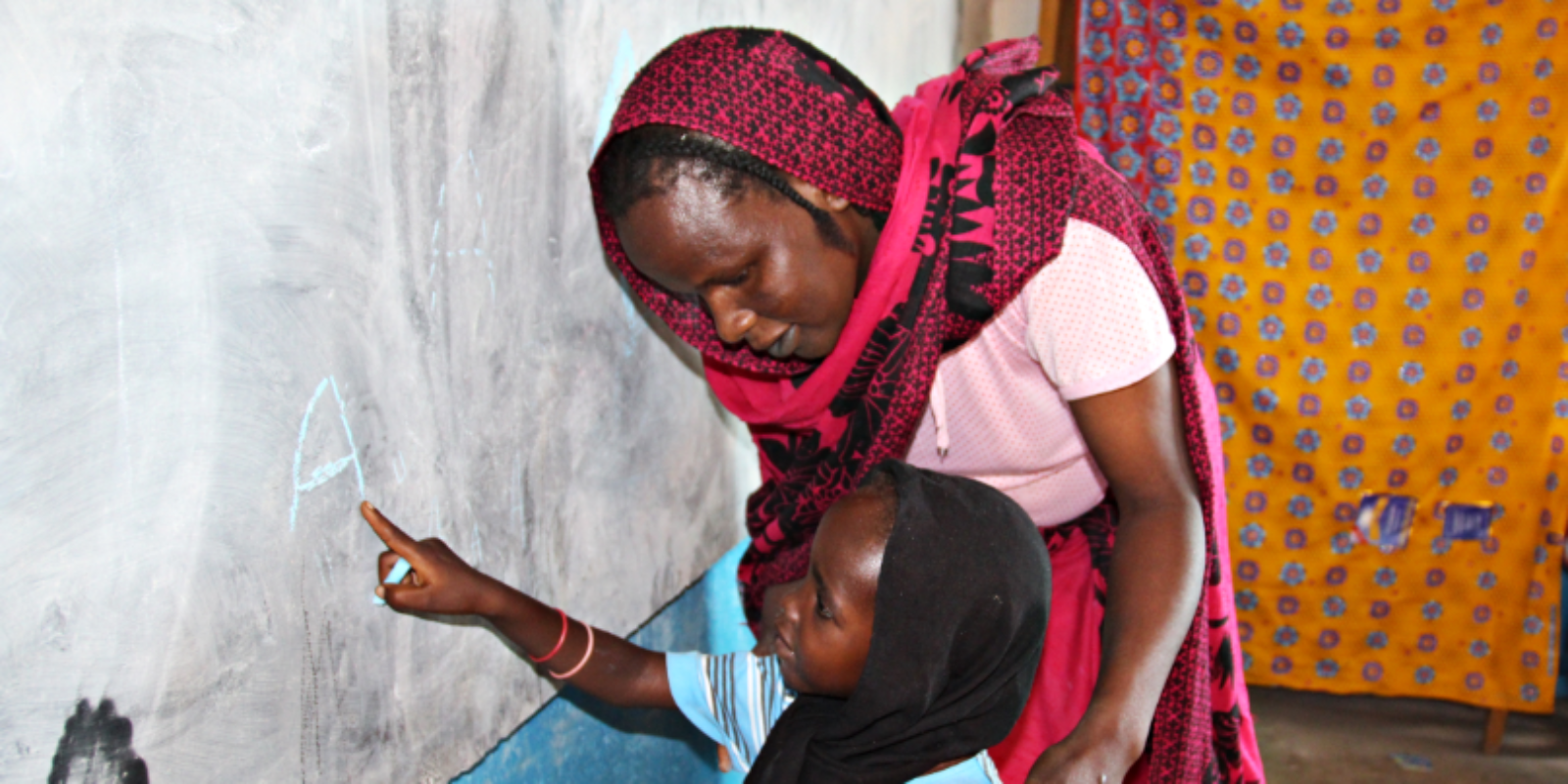 A teacher and her student at one of the JRS-run schools in Goz Beïda, Chad.