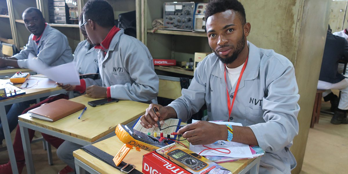 The electronics class is part of vocational programs in Kampala created in partnership with the techical institute . Students learn how to do electrical work on phones, television, and radio repair.