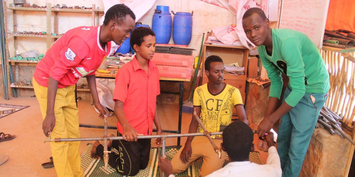 Somali refugees learn plumbing skills as part of the JRS livelihoods project in Melkadida refugee camp. Some graduates have gone on to work for NGOs or businesses in the community.