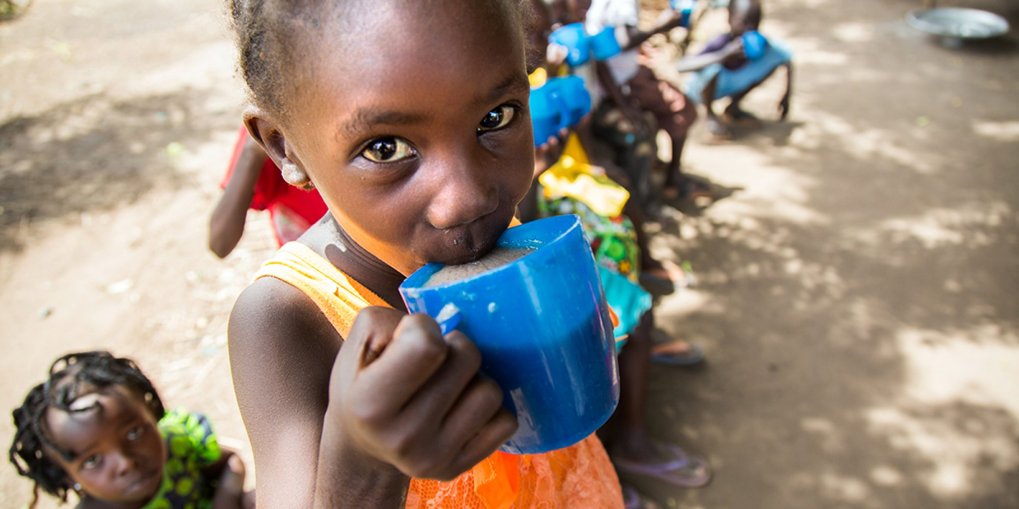 A girl has her lunch at the Gulawein school, in Maban, South Sudan.