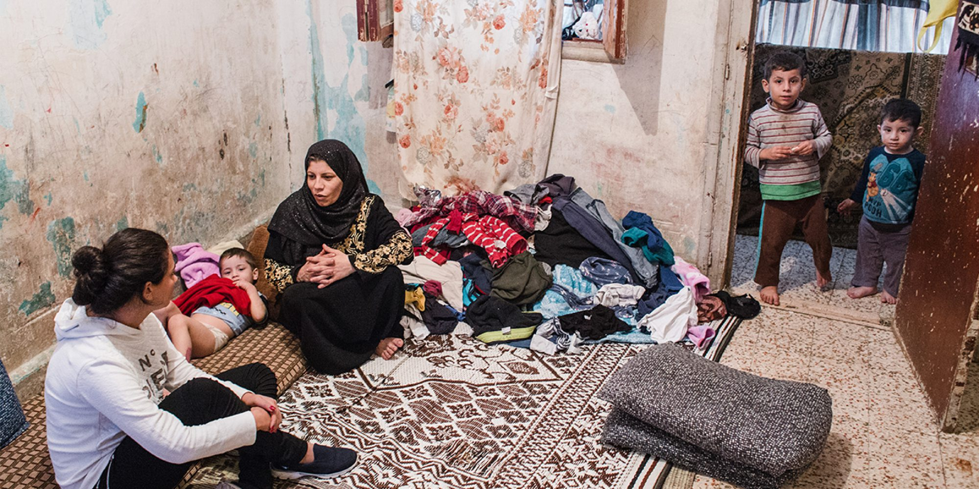 JRS Syria staff visits a Syrian family living in Beirut to conduct need assessments