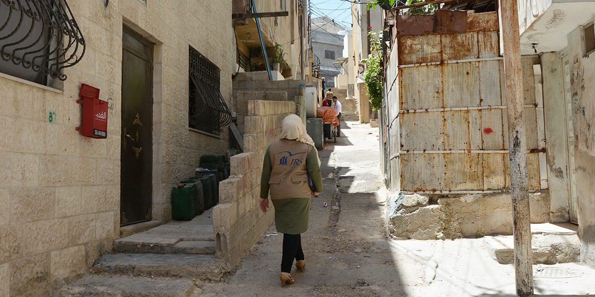 A JRS Jordan home visits team member walks in the streets of Amman to meet and listen to refugees and asylums seekers and assess their needs.