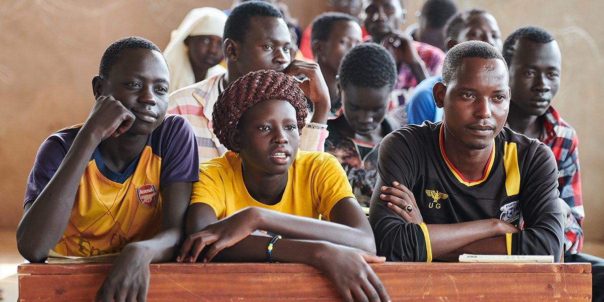 Students in an English class in the Arrupe Learning Center, run by JRS in Bunj, South Sudan. Participants come from four refugee camps in Maban County that together shelter more than 130,000 refugees from the Blue Nile region of Sudan, along with local residents from the host community.