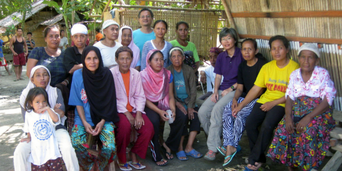 Displaced persons attend a meeting hosted by Jesuit Refugee Service staff in Maguindanao, Philippines.