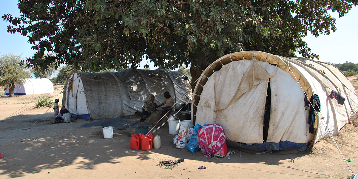 Refugees near tents in the Tongogara camp.