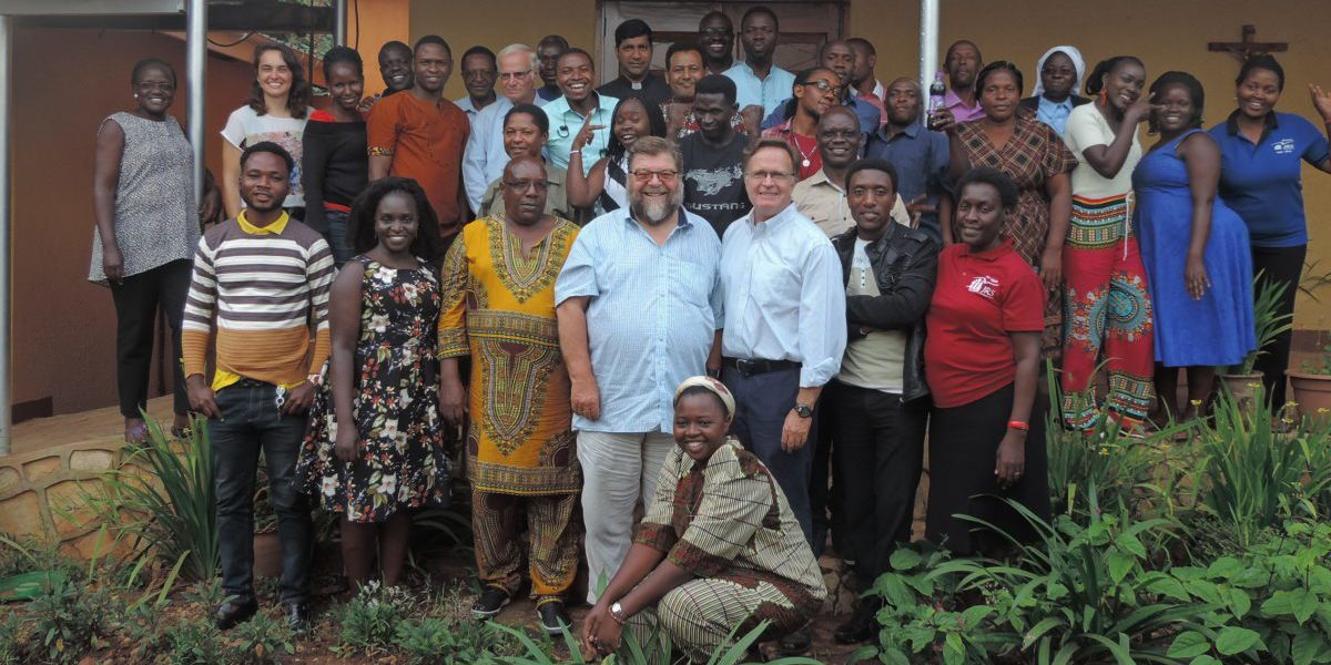 JRS Uganda team with Fr Frido Pflueger SJ and Fr Kevin White SJ.