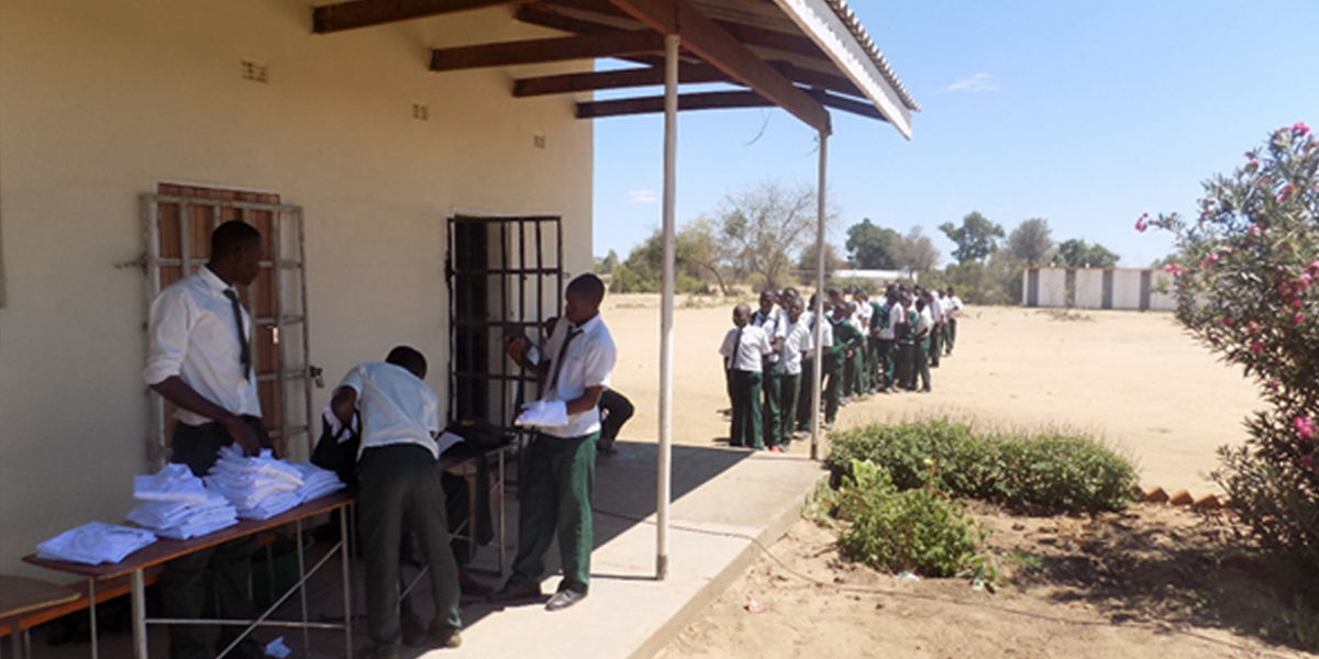 Student wait in line to receive their new school uniforms.