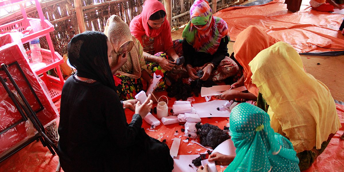 Refugee girls making handicrafts for younger children in the Child Friendly Spaces (CFS)