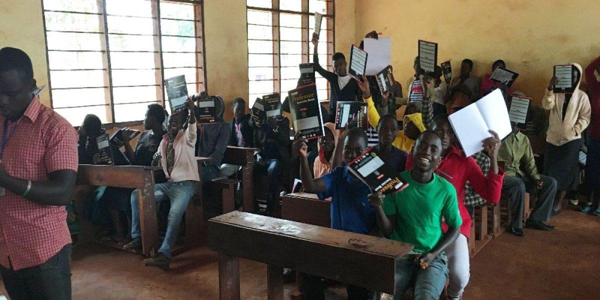 Students showing off their newly received school materials in Kigoma, Tanzania. (Jesuit Refugee Service)