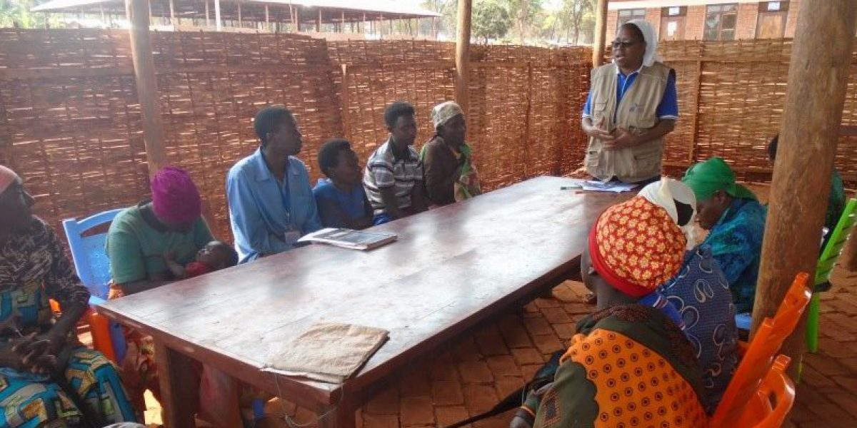 The domestic violence listening group attends a meeting with Sr. Regina, member of the JRS Psychosocial team in Kigoma, Tanzania. (Jesuit Refugee Service)