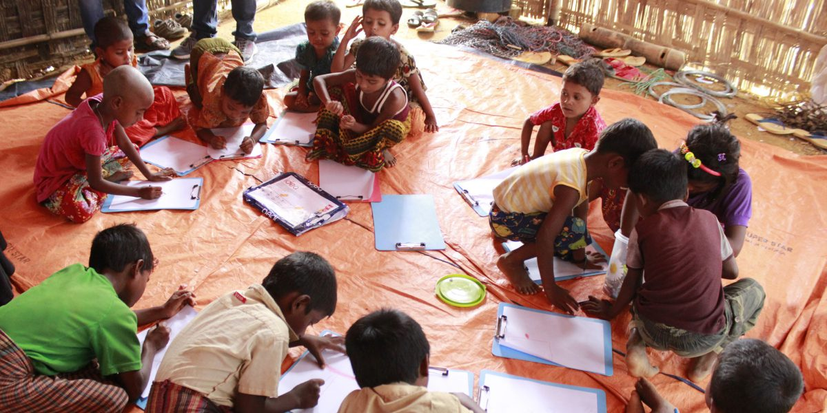 Rohingya children engaged in learning activities at one of the JRS Child Friendly Spaces (CFS) in Cox's Bazar.