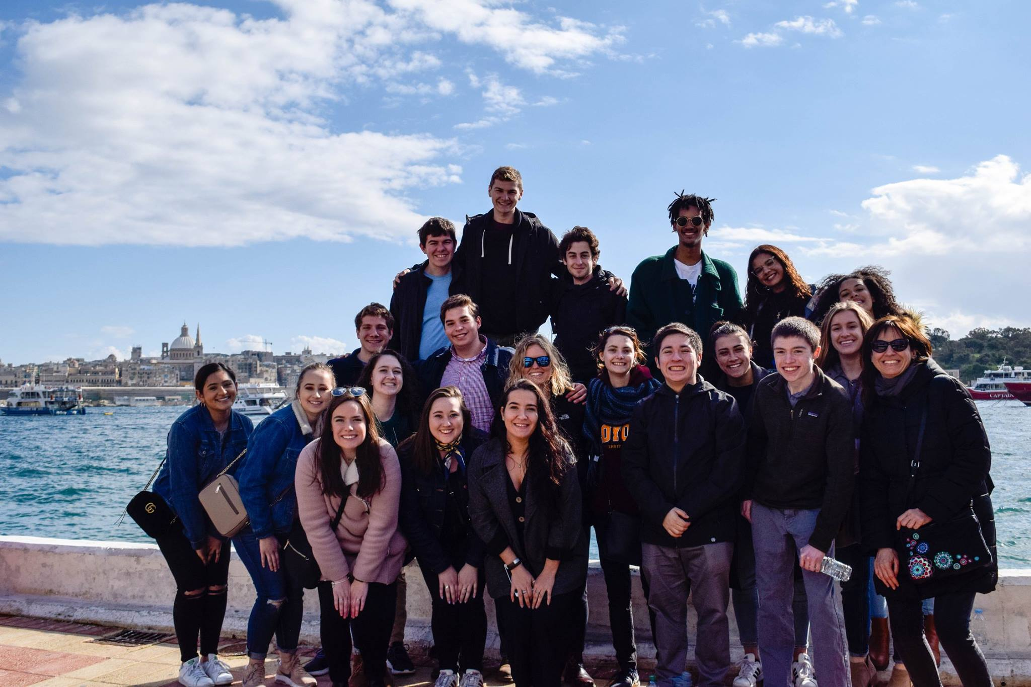 A group of students from Loyola University Chicago's John Felice Rome Centre poses for a photo in Malta where they learned about the refugee situation in the country (Ola Wysocki)