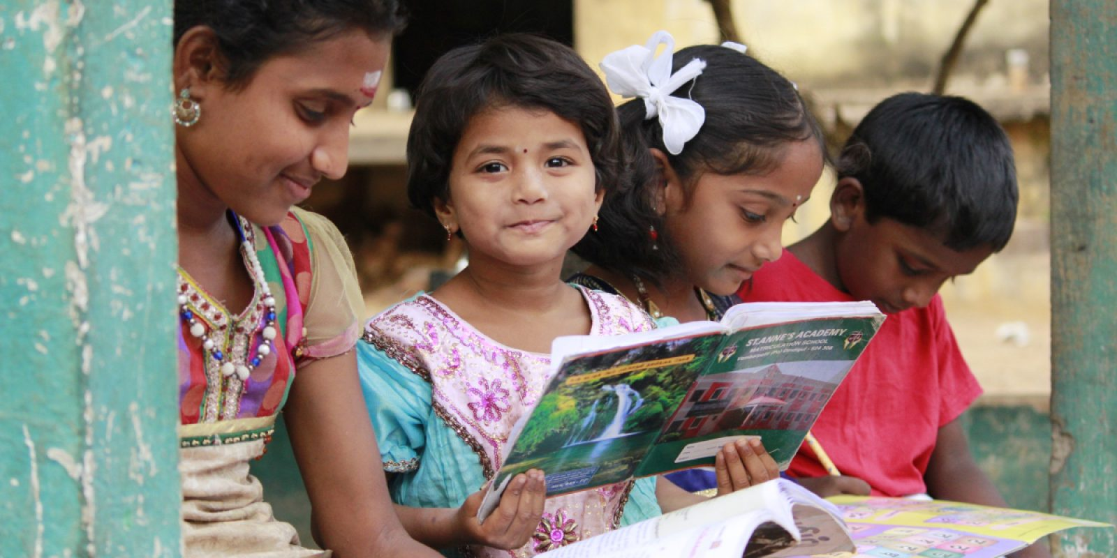 Students at the Jesuit Refugee Service Complementary Education Centre practice reading. (Jesuit Refugee Service)