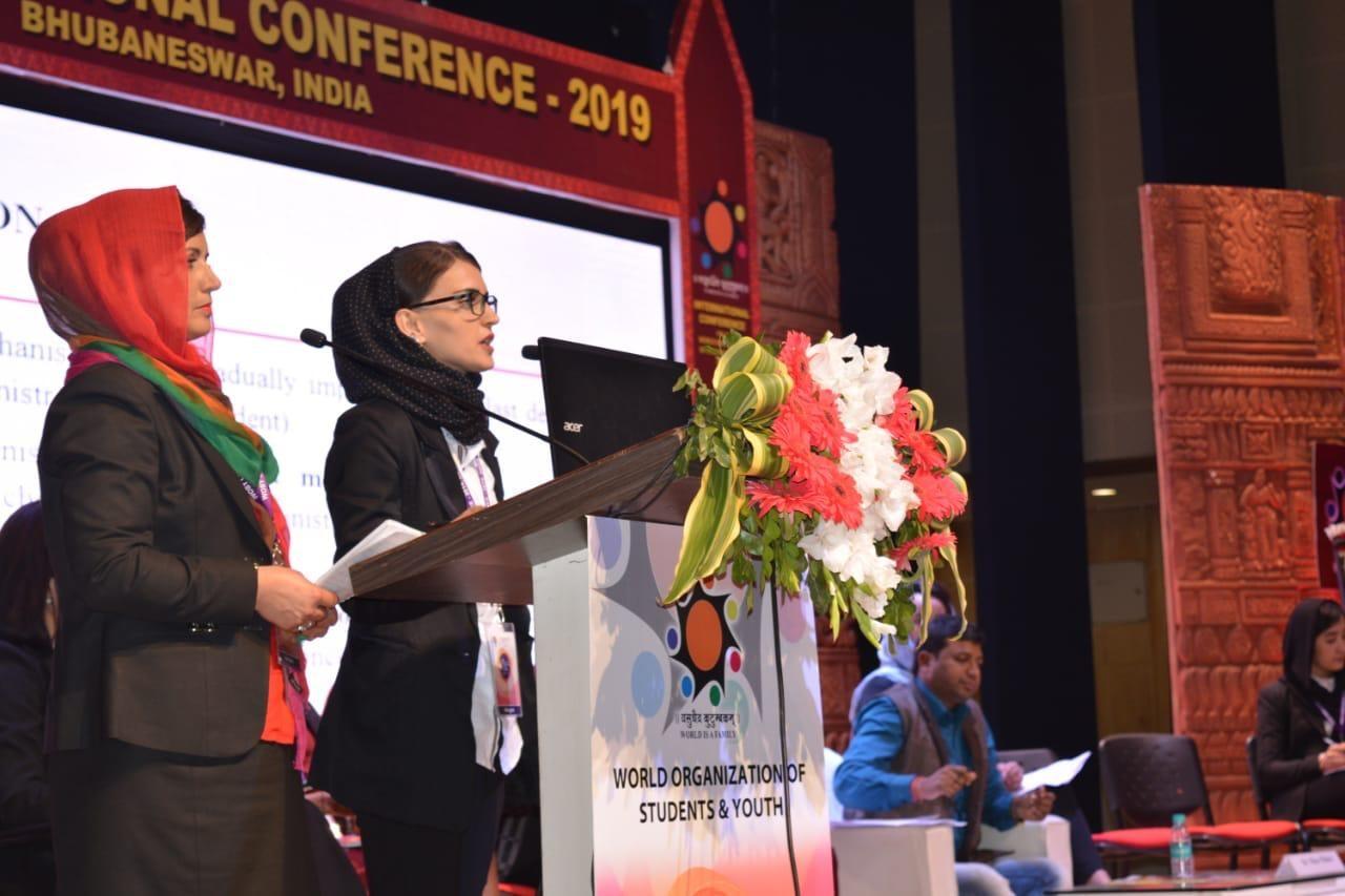 Bashria Jan Sarwari gives a speech at a student ceremony. (Jesuit Refugee Service)