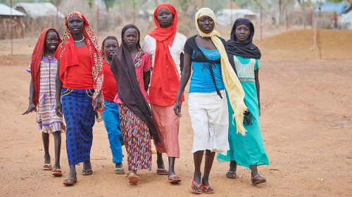 Girls walk to school in the Kaya Refugee Camp in Maban County, South Sudan.