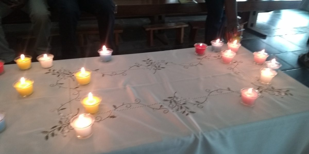 As part of an exercise during the reconciliation workshop, candles are seen together on the table. They represent the light and peace that reconciliation can bring, especially when we are united in our mission. (Jesuit Refugee Service)