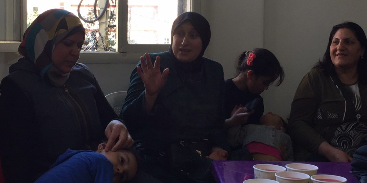 Women and their children come together in Lebanon to share stories. (Jesuit Refugee Service)