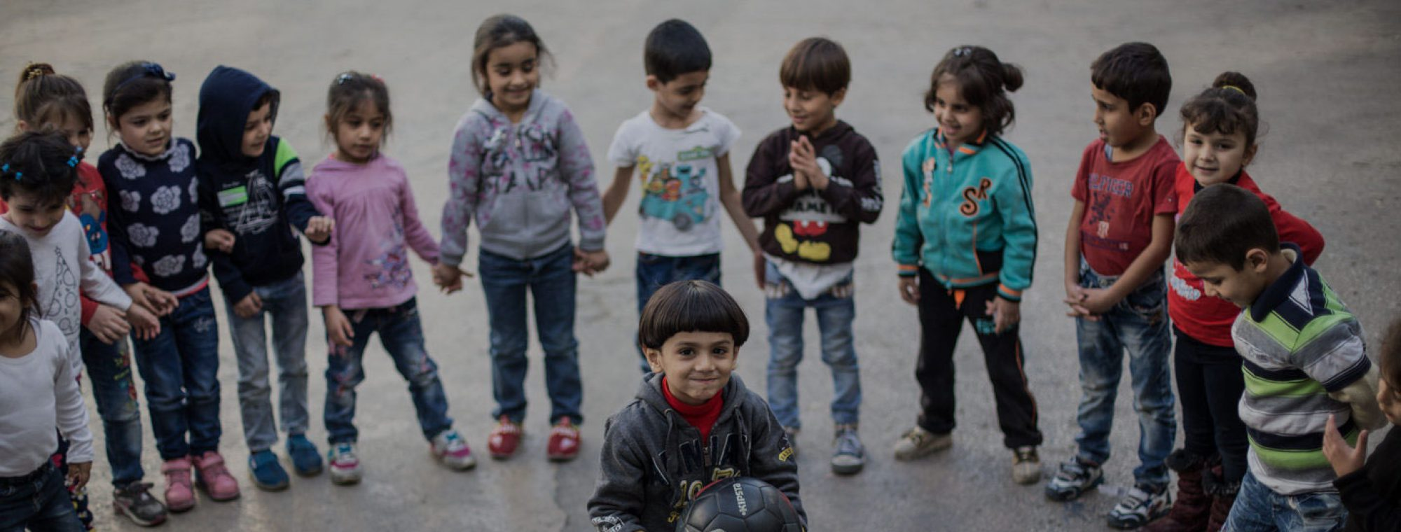 Refugee children playing at a JRS school in Lebanon. (Kristof Holvenyi/Jesuit Refugee Service)