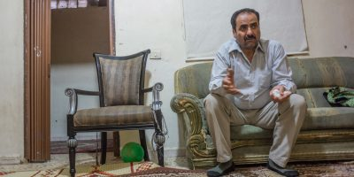 A man shares his story from his apartment in Beirut. (Fr Don Doll SJ / Jesuit Refugee Service)