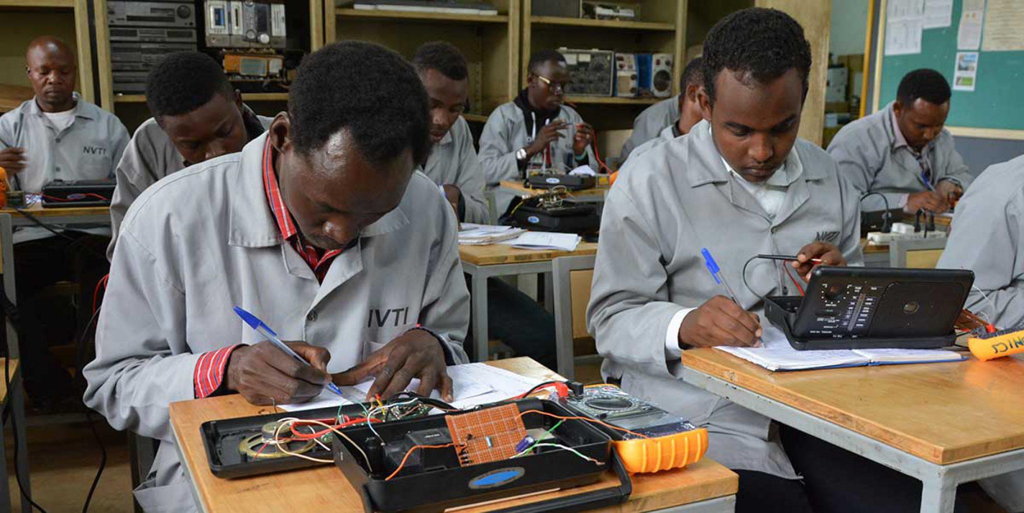 Students attending JRS Electronics classes in Kampala, Uganda.