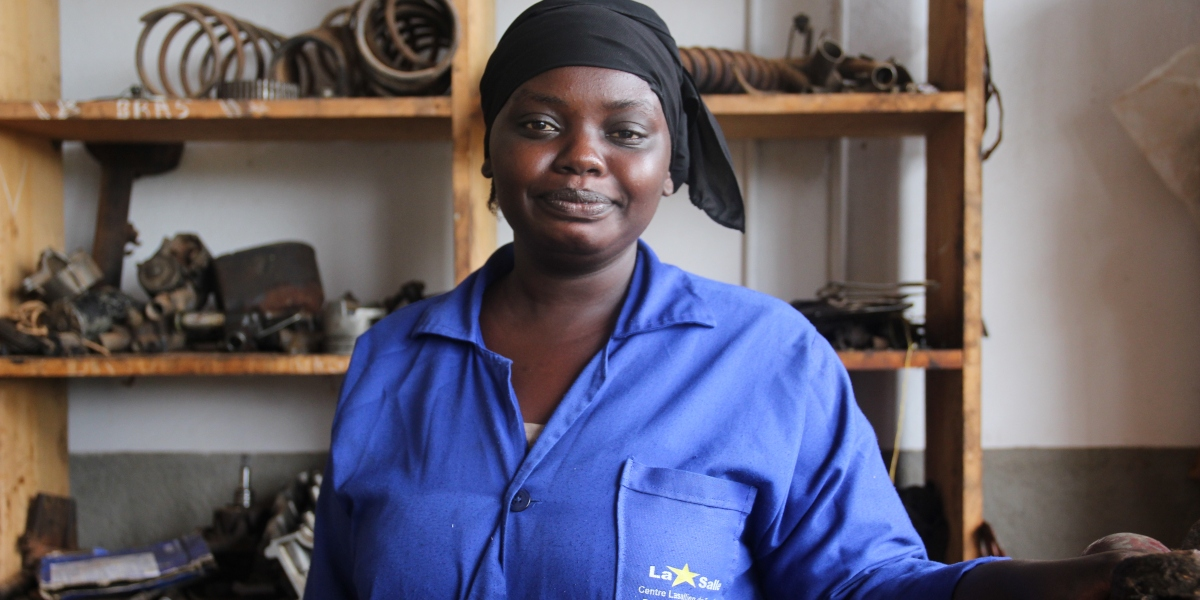 Harouna smiles in her workshop. (Jesuit Refugee Service)