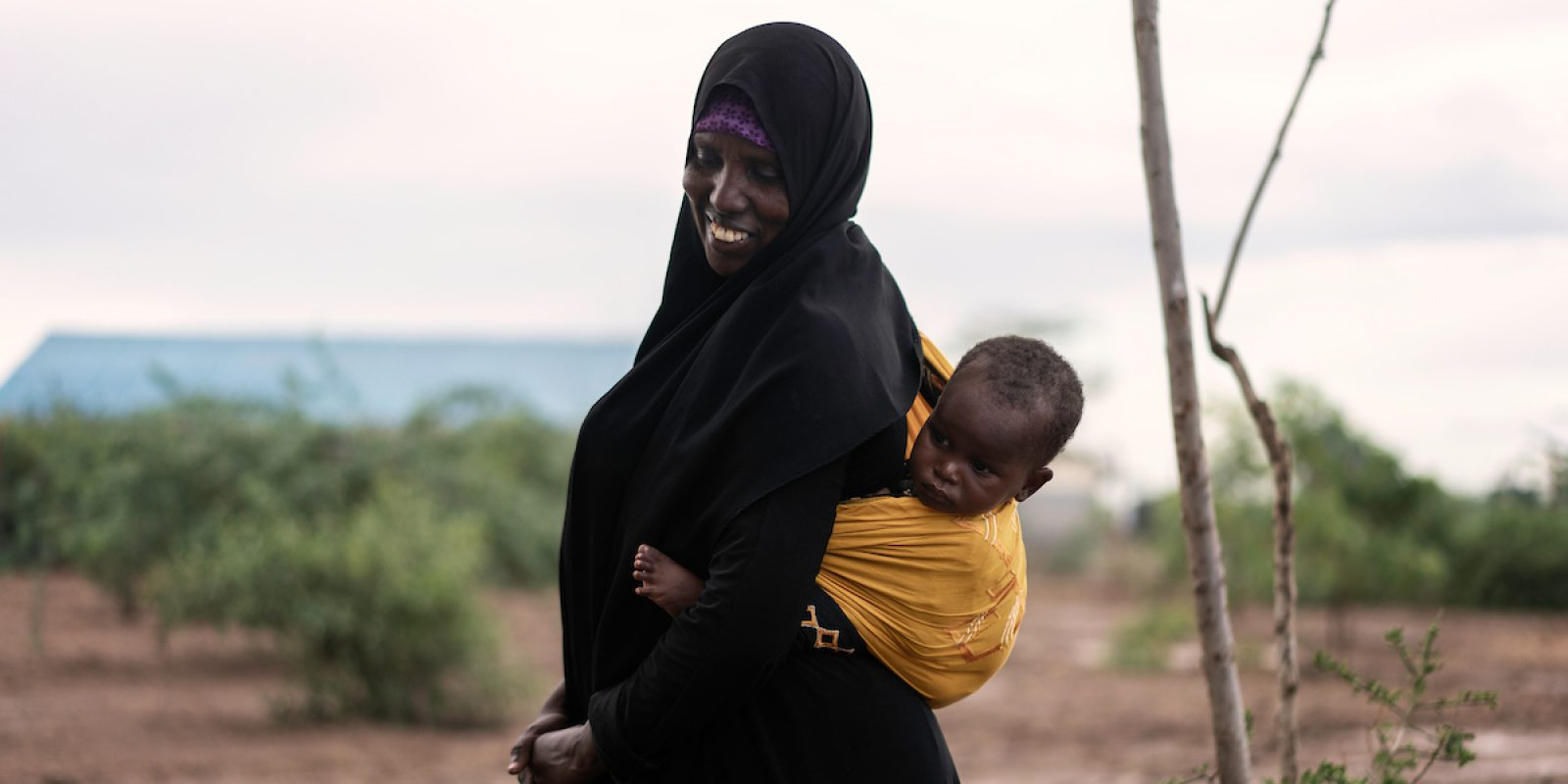 Rahma came to Kakuma as a refugee from Ethiopia together with her husband and oldest son in 2018, While her 8 other children remained behind. She took a training and now work as a JRS staff for the Special Need unit in centre 4. She also adopted baby Blaze, who was left alone by her parents. (Fredrik Lerneryd/Jesuit Refugee Service)