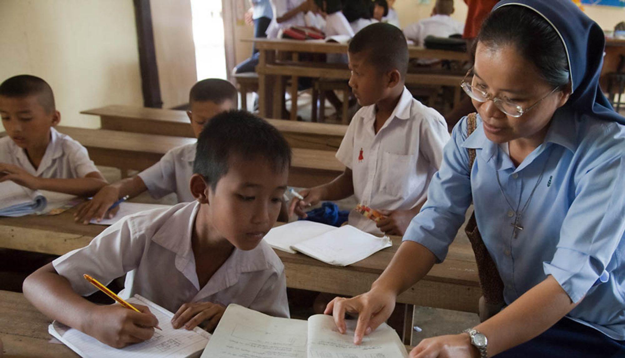 Nun mentoring a student in a training center for Burmese children in Thailand.