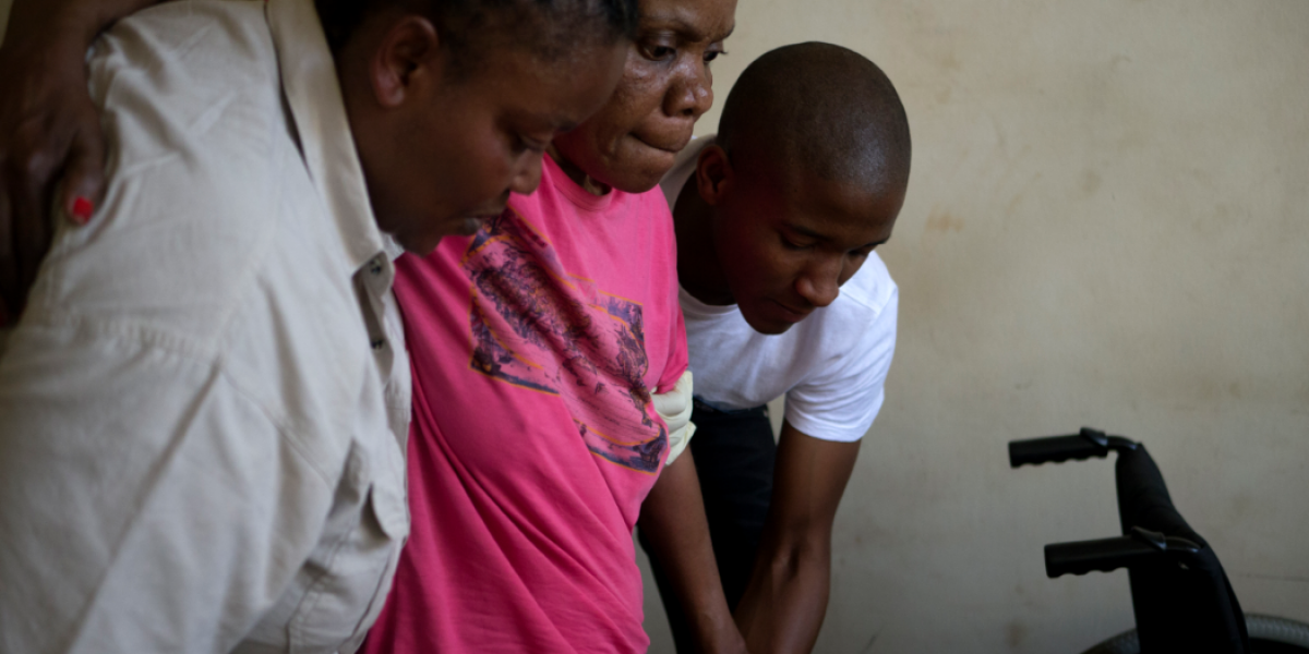 Estelle, an asylum seeker from the DRC living in Johannesburg, walks assisted by Marceline, head of JRS's health department and a JRS volunteer.